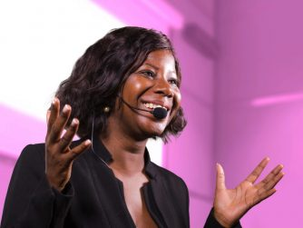Highlight your skills Third Culture Africans Woman speaking with hands and head microphone