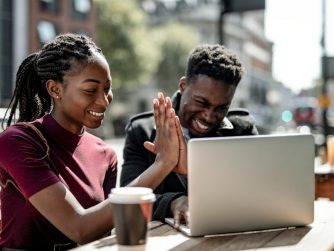 Third Culture Africans team success third culture africans a young lady and man congratulating one another in front of a laptop